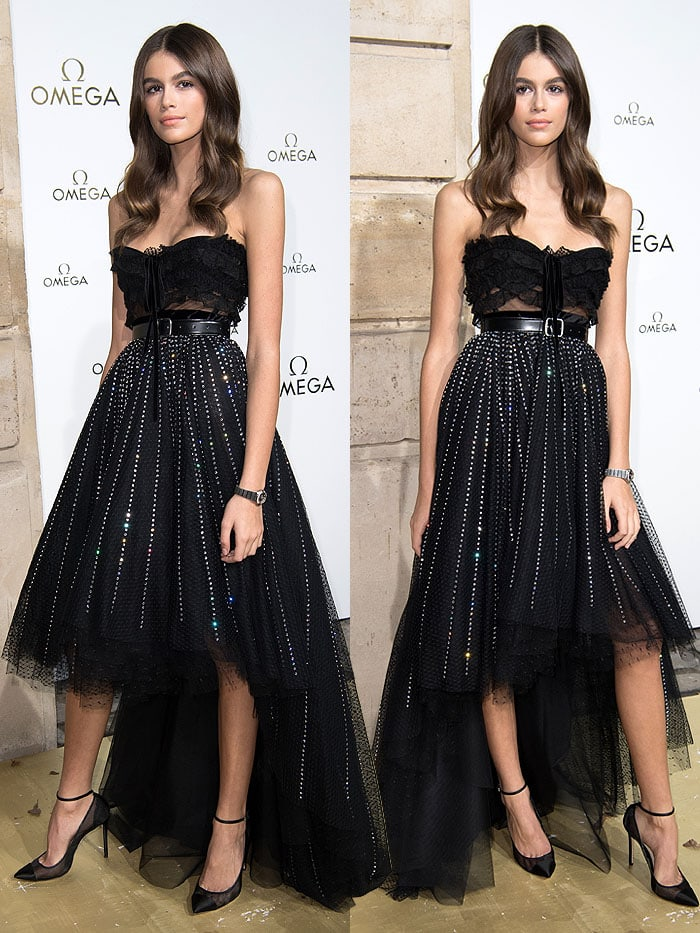 Kaia Gerber wearing a Philosophy Di Lorenzo Serafini Fall 2017 strapless dress, the Omega Constellation watch, and Jimmy Choo 'Tower' pumps.