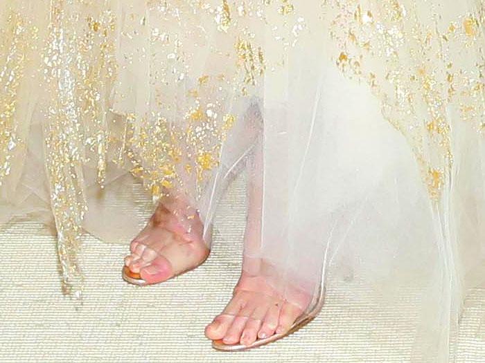 Kate Bosworth's feet in Manolo Blahnik 'Estro' clear-strap ankle-tie sandals.