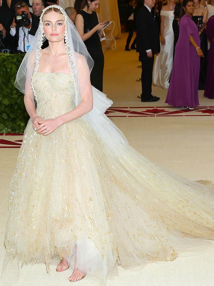 Kate Bosworth wearing an Oscar de la Renta gown and veil with Manolo Blahnik 'Estro' sandals.