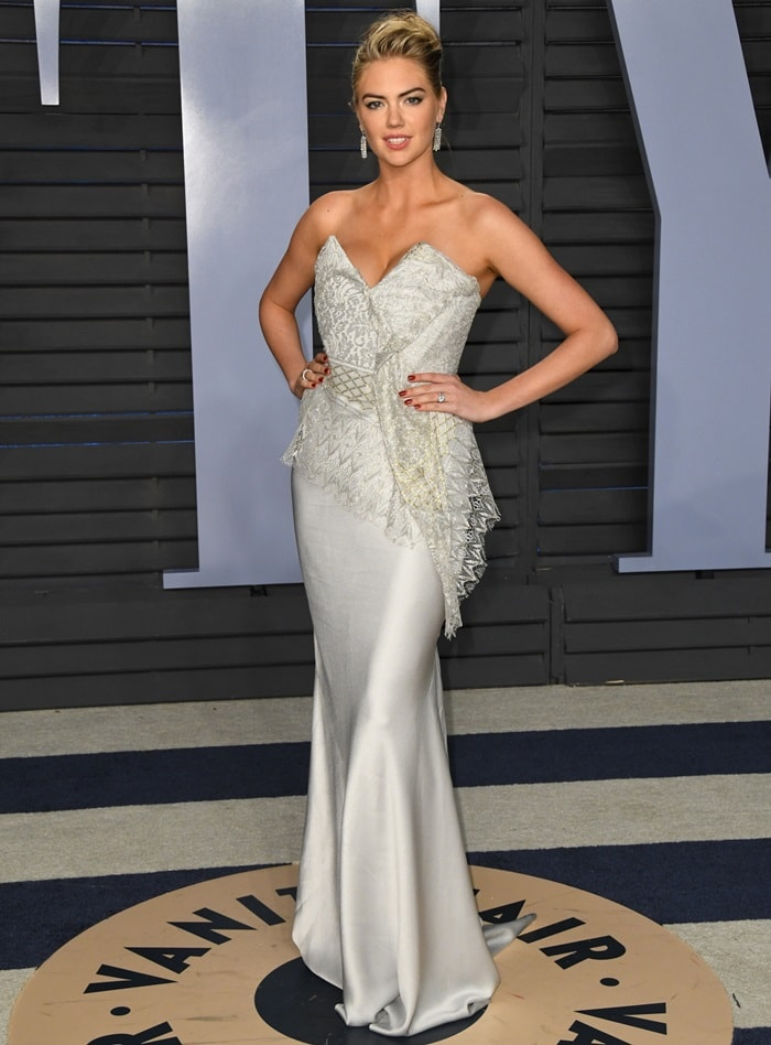 Kate Upton in a Vivienne Westwood Couture gown styled with jewelry by Anita Ko, Hearts On Fire, and Le Vian