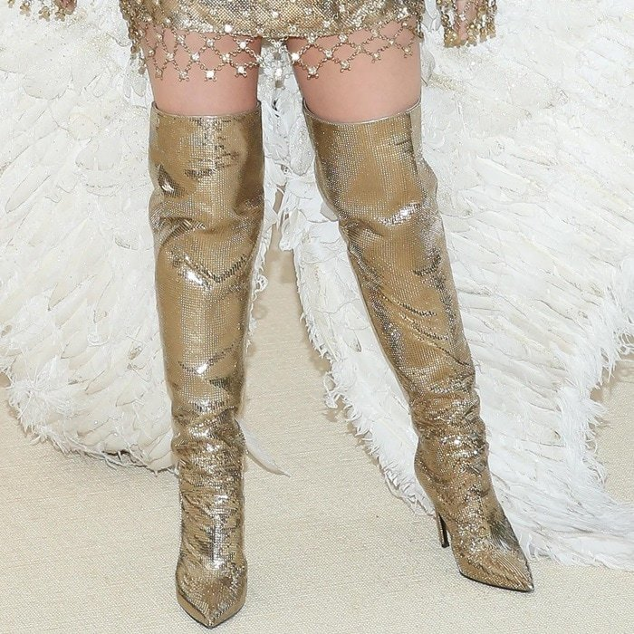 Katy Perry'sgold thigh-high boots