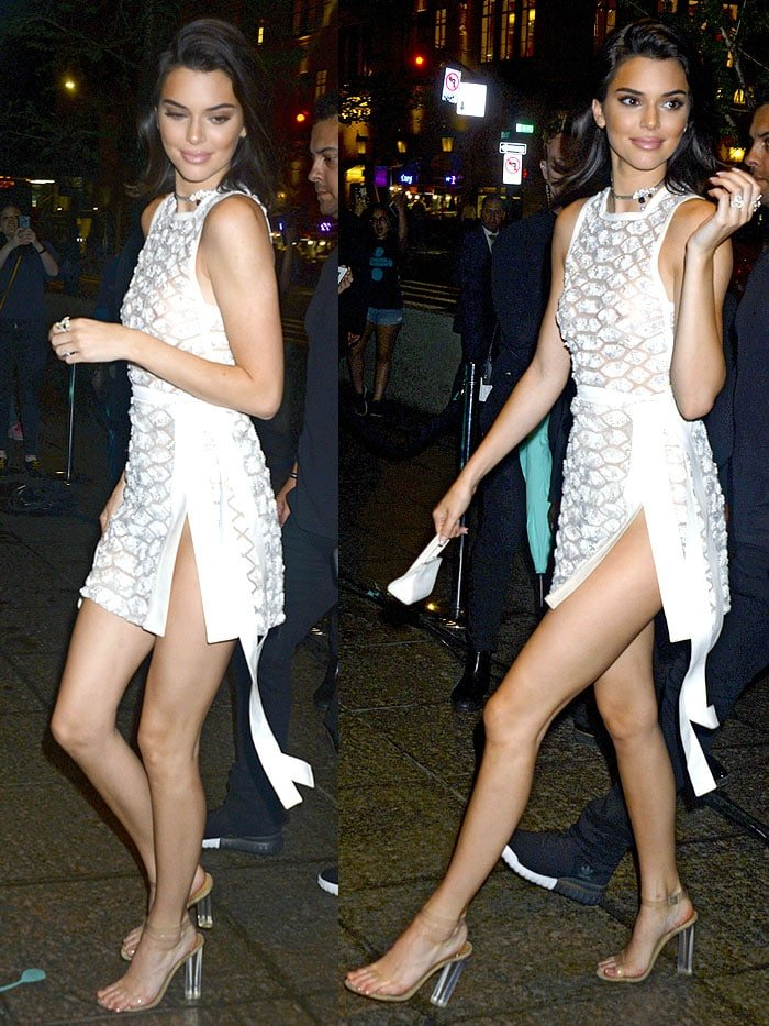Kendall Jenner in Yeezy Season 6 clear heels and an Elie Saab little white dress.