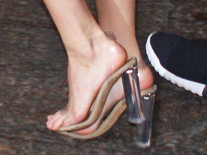 Closeup of Kendall Jenner's Yeezy Season 6 lucite heels.
