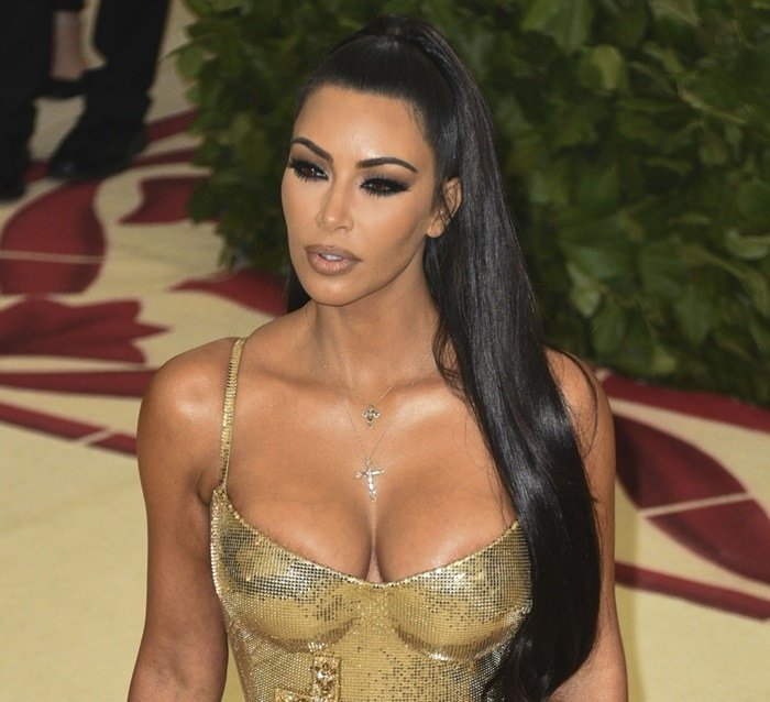 Kim Kardashian accessorized withtwo cross necklaces