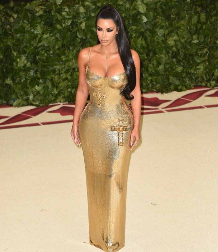 Kim Kardashian in acrucifix-embellished skin-tightAtelier Versace chainmail floor length gown