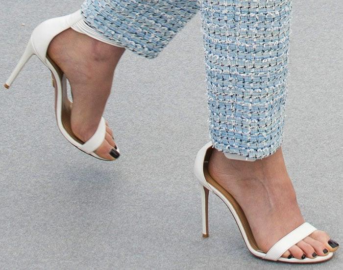Kristen Stewart's feet in white Aquazzura 'Casablanca' sandals.