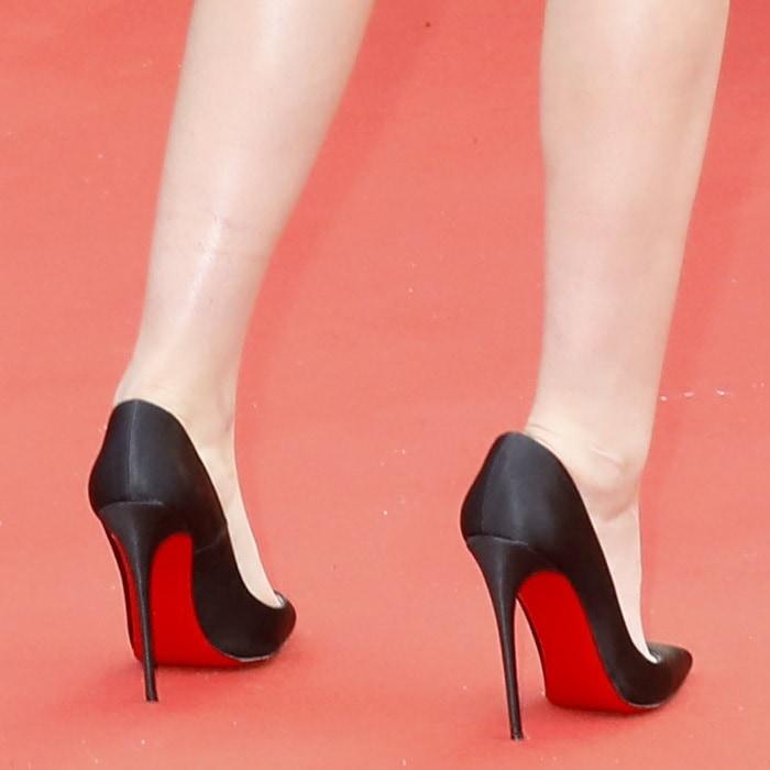 Kristen Stewart wearing black 'So Kate' red bottom pumps
