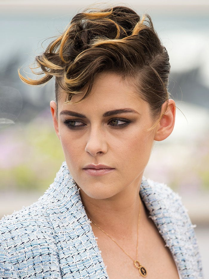 Kristen Stewart with a blonde-and-brown messy-top short hairdo.