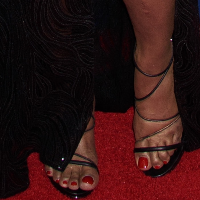 Laverne Cox showing off her 13 US (47 EU) feet in custom Kenneth Cole sandals