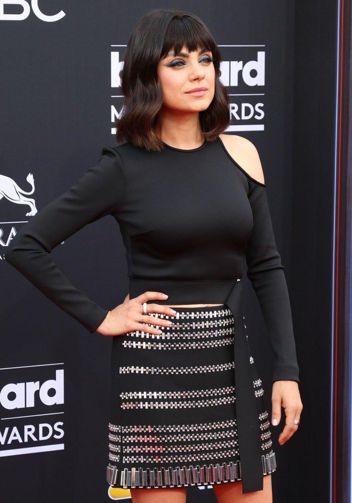 Mila Kunis rocking a black and silver crystal-embellished cady skirt