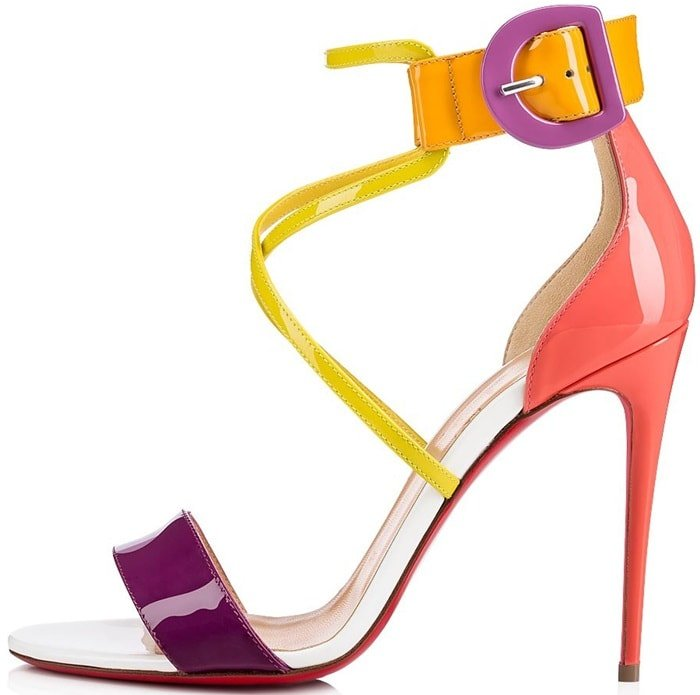 This high-heeled patent leather sandal in vibrant retro tones features an aerial cut with an upper double strap and adjustable ankle strap