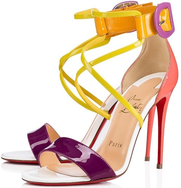 Thishigh-heeled patent leather sandal in vibrant retro tones features an aerial cut with an upper double strap and adjustable ankle strap