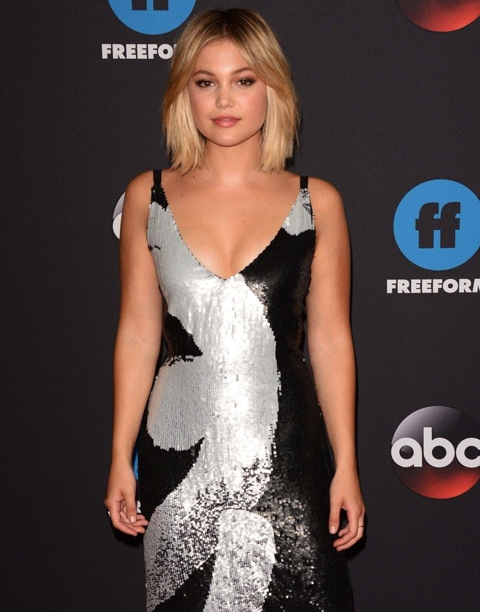 Olivia Holt wearing a striking Cushnie Et Ochs two-tone sequin cocktail dress