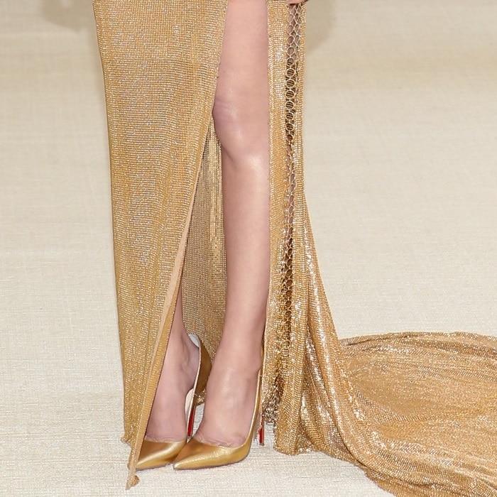 Olivia Munn's gold pointy-toe Christian Louboutin pumps