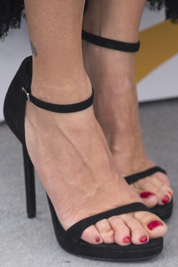 Penelope Cruz's feet in Versace black-suede ankle-strap sandals.