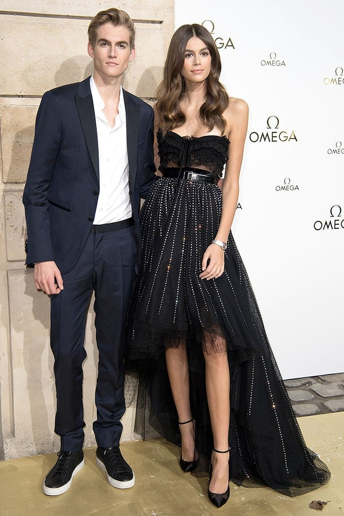"Presley Gerber and Kaia Gerber posing together at the ""Her Time"" Omega photocall."