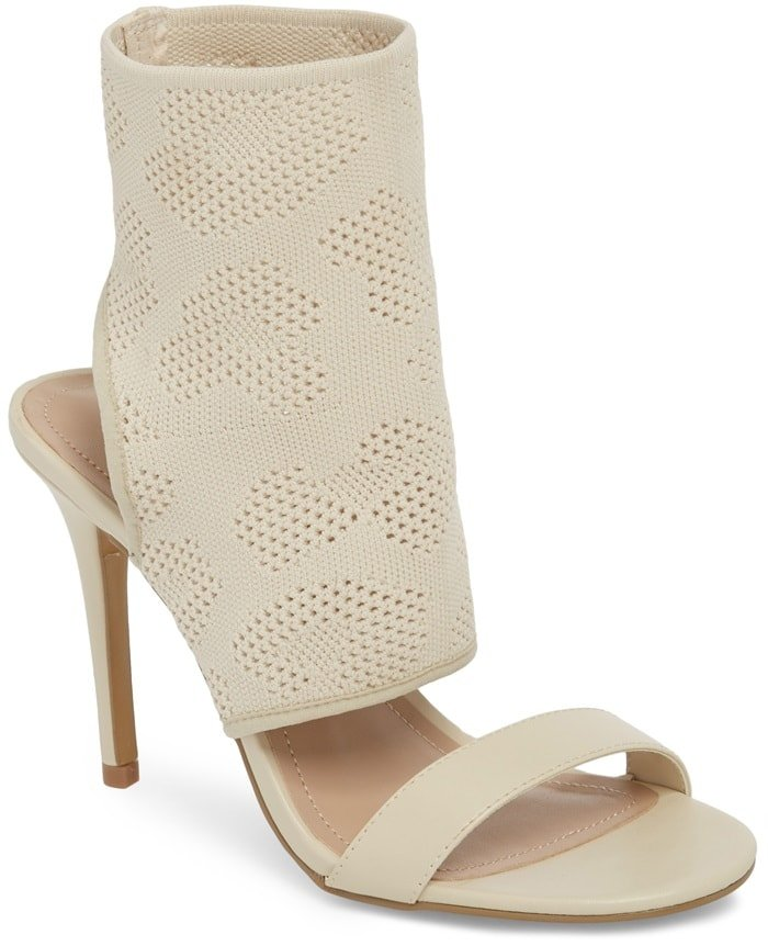 A stretchy knit cuff refreshes the look of an otherwise simple sandal lifted by a tapered heel