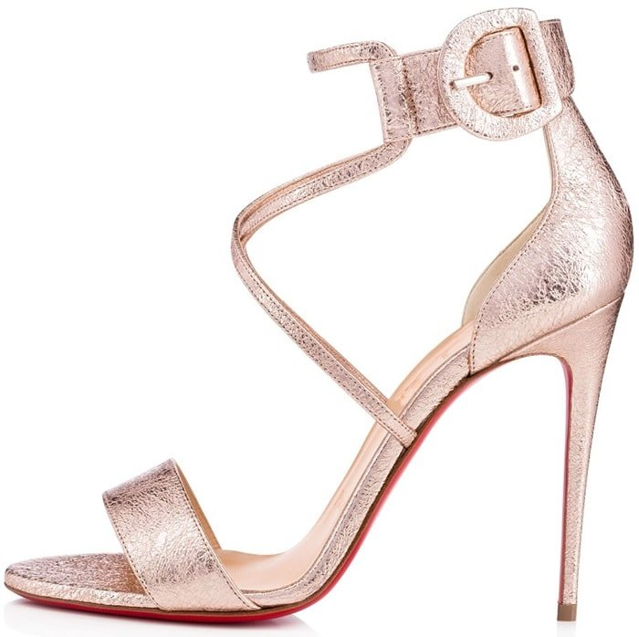 These stiletto sandals have rose gold cracked-leather straps that frame your feet and shimmer brilliantly in the light