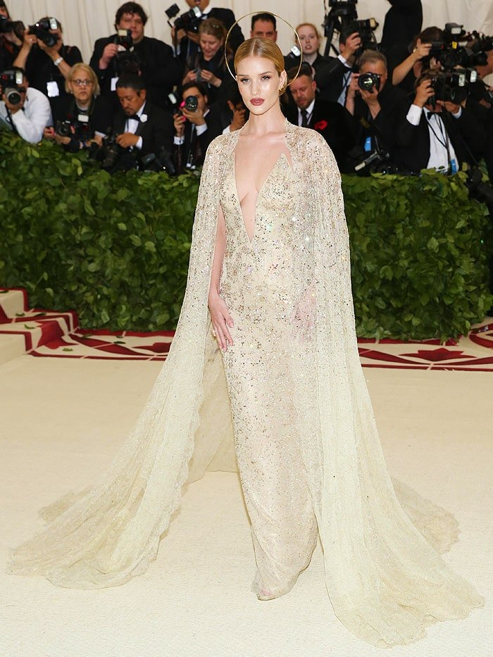 Rosie Huntington Whiteley wearing Ralph Lauren Collection gold embellished gown and gold Jimmy Choo 'Kaylee' sandals at the 2018 Met Gala.