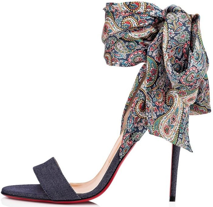 This colorful pair features an open toe and a leg lengthening, denim-covered stiletto heel