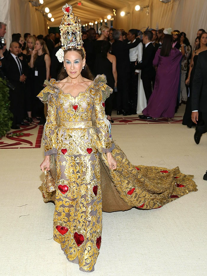 Sarah Jessica Parker in a Dolce & Gabbana Alta Moda gold baroque heart-embellished gown and nativity altar headpiece.
