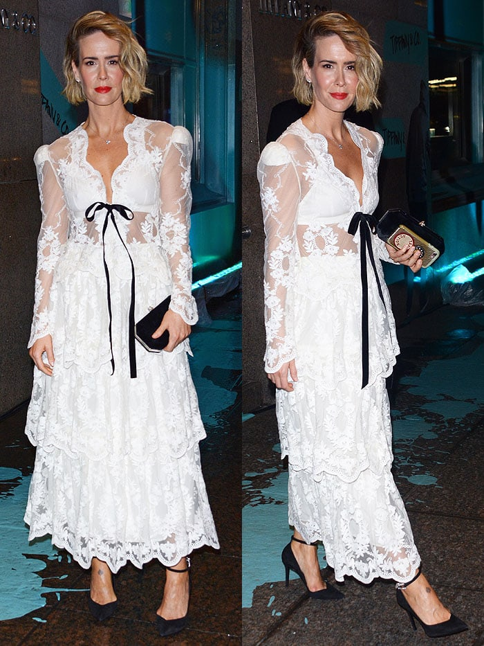 Sarah Paulson wearing a Brock Collection Fall 2018 white-lace long-sleeve dress