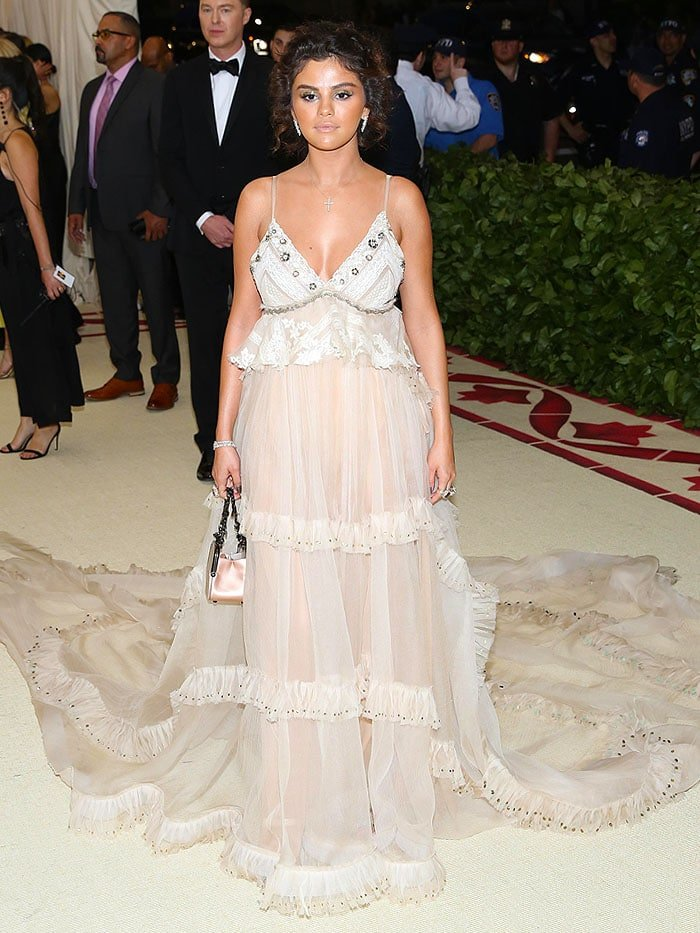 Selena Gomez with a spray tan in a custom Coach vintage silk-gauze slip gown.