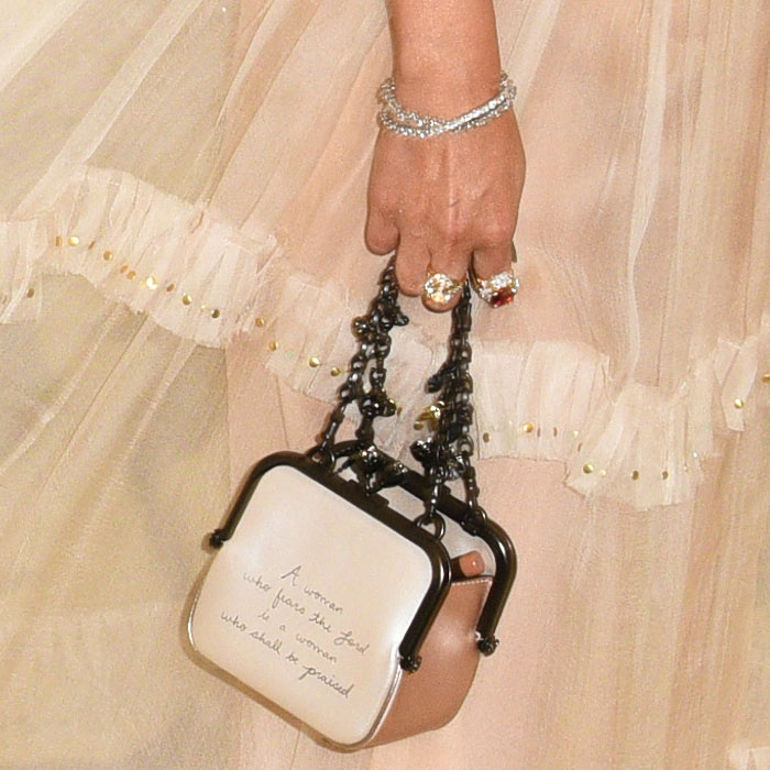 Details of Selena Gomez's custom Coach 'Kisslock Frame' bag inscribed with Proverbs 31:30.