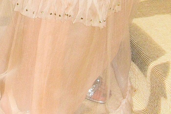 Selena Gomez's custom Coach silver ankle-strap sandals.