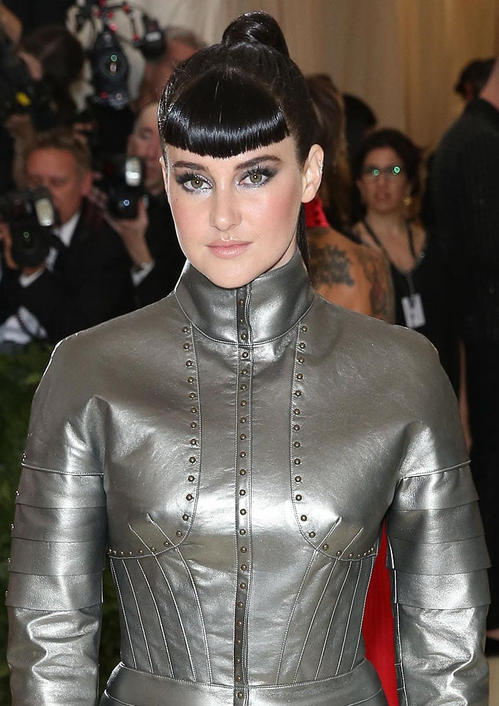 Shailene Woodley with blunt bangs in custom Ralph Lauren armor dress.