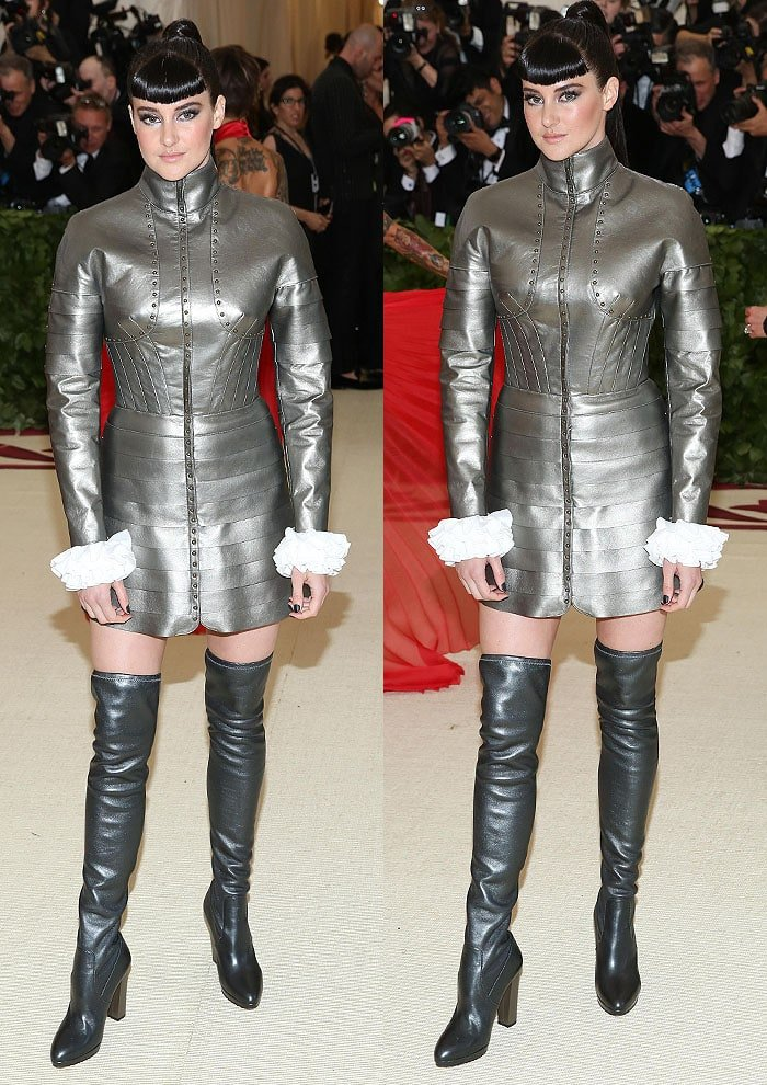 Shailene Woodley in a silver Ralph Lauren Collection armor dress and silver thigh-high boots at the 2018 Met Gala.