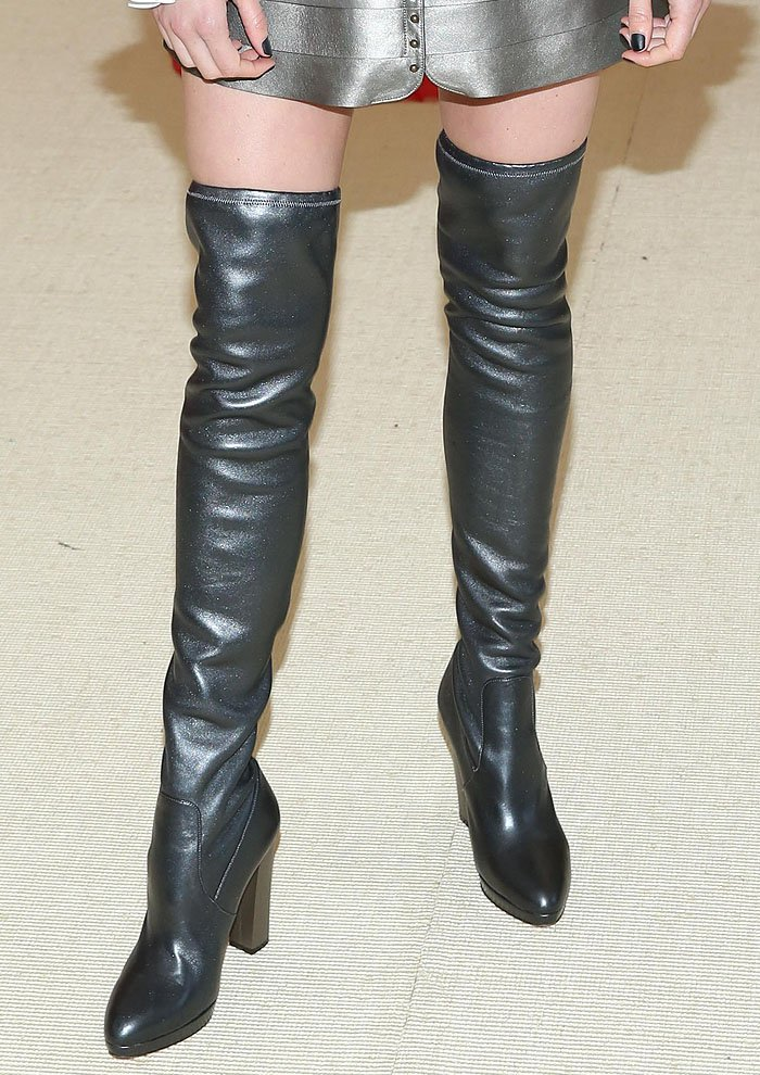 Closeup of Shailene Woodley's silver thigh-high boots