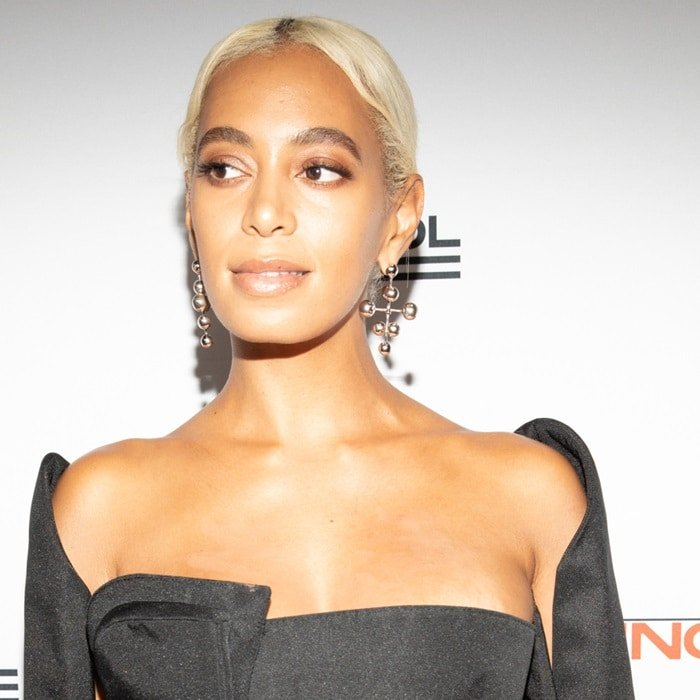 Solange Knowles showing off her silver earrings at the 2018 Parsons Benefit