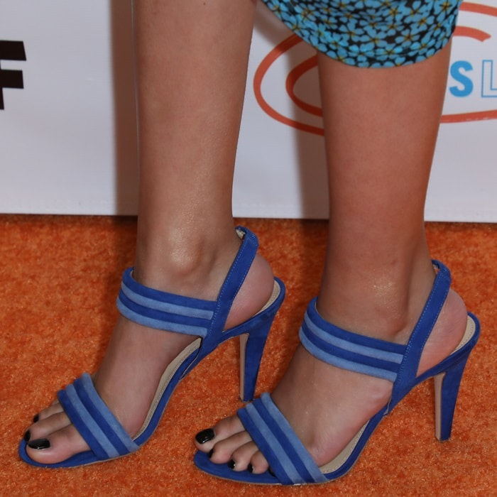 Storm Reid showing off her feet in strappy blue sandals