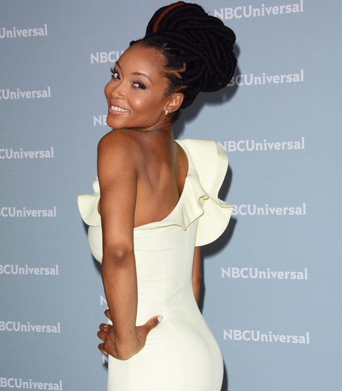 Yaya DaCosta in a one shoulder cocktail dress with a ruffled neckline from Nha Khanh at the NBCUniversal Upfront campaign event at Radio City Music Hall in New York City on May 14, 2018