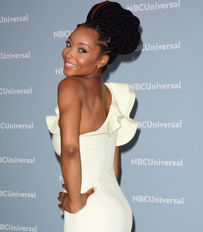 Yaya DaCosta in a one shoulder cocktail dress with a ruffled neckline from Nha Khanh atthe NBCUniversal Upfront campaign event at Radio City Music Hall in New York City on May 14, 2018