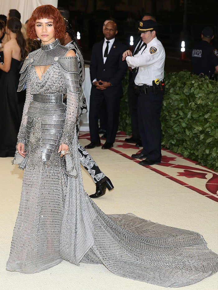 Zendaya wearing Atelier Versace armor gown and silver Jimmy Choo 'Max' sandals at the 2018 Met Gala.