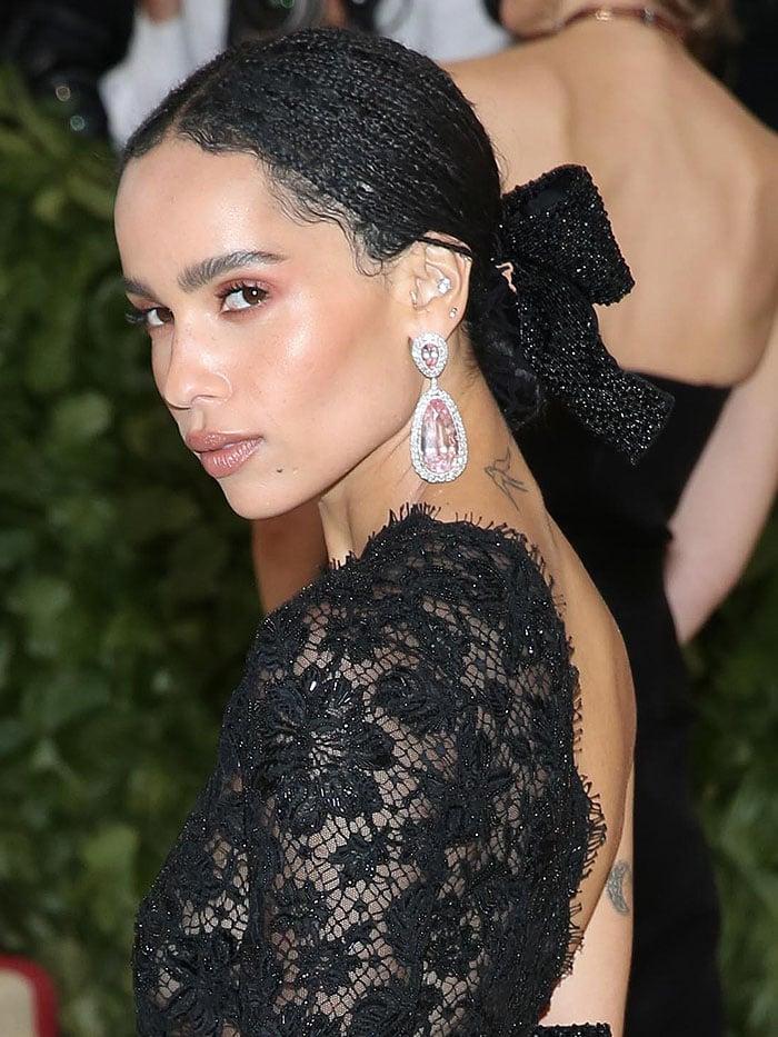Zoe Kravitz wearing dazzling Jacob & Co. pink-diamond drop earrings.