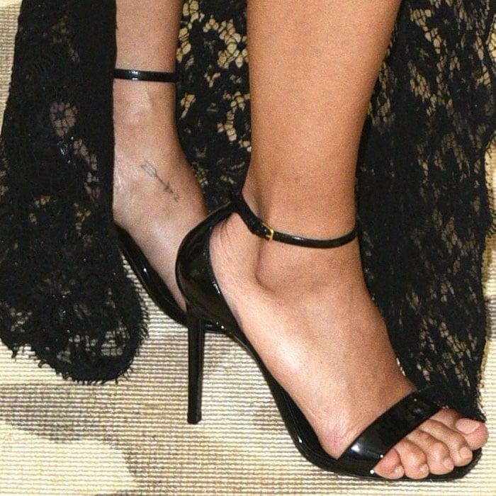 Zoe Kravitz's feet in Saint Laurent 'Amber' black-patent ankle-strap sandals.
