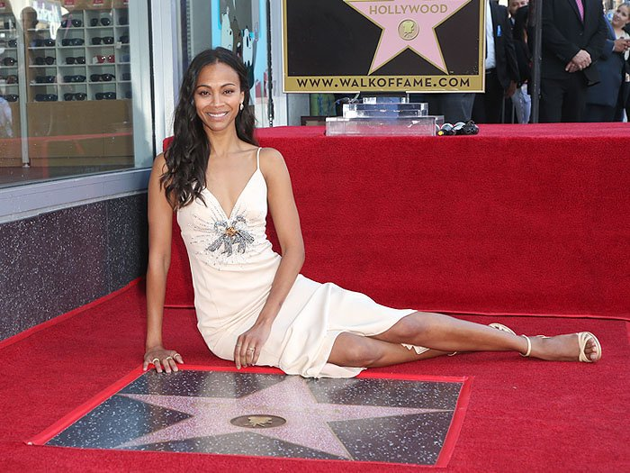 Zoe Saldana with her star on the Hollywood Walk of Fame.