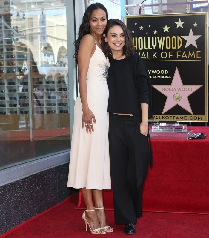 Mila Kunis rocking black Oxfords from Frye featuring hand-applied micro studs