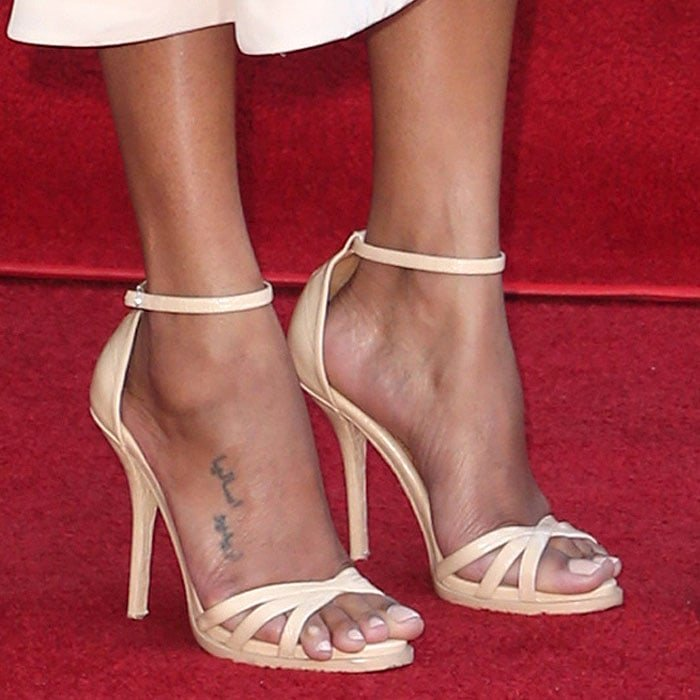 Zoe Saldana with a slight toe overhang and corn situation in Miu Miu beige-leather ankle-strap sandals.