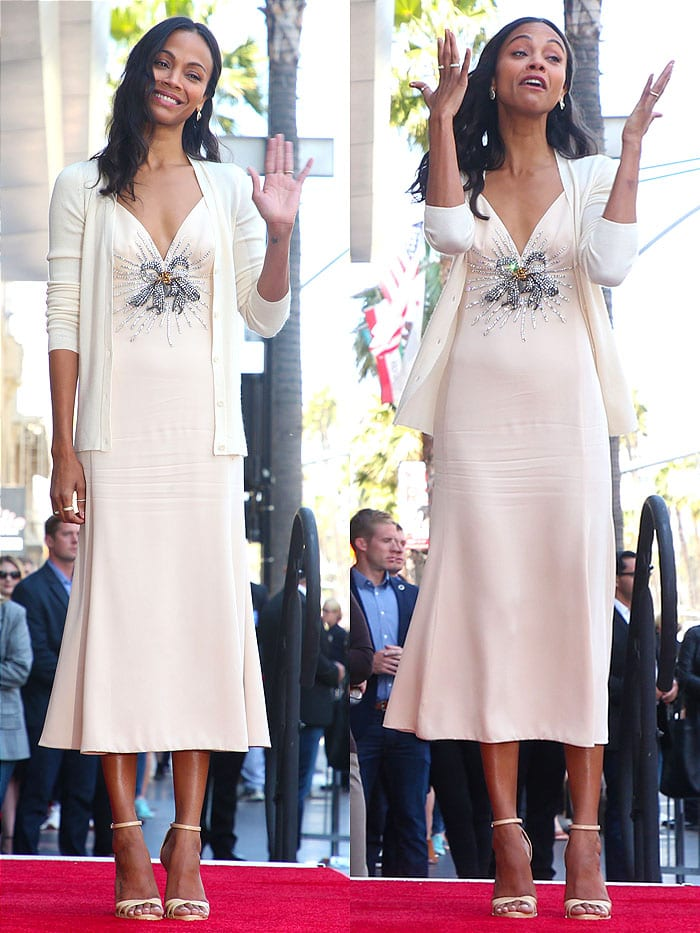 Zoe Saldana in a blush-pink Miu Miu crystal-ribbon slip dress and beige-leather ankle-strap sandals.
