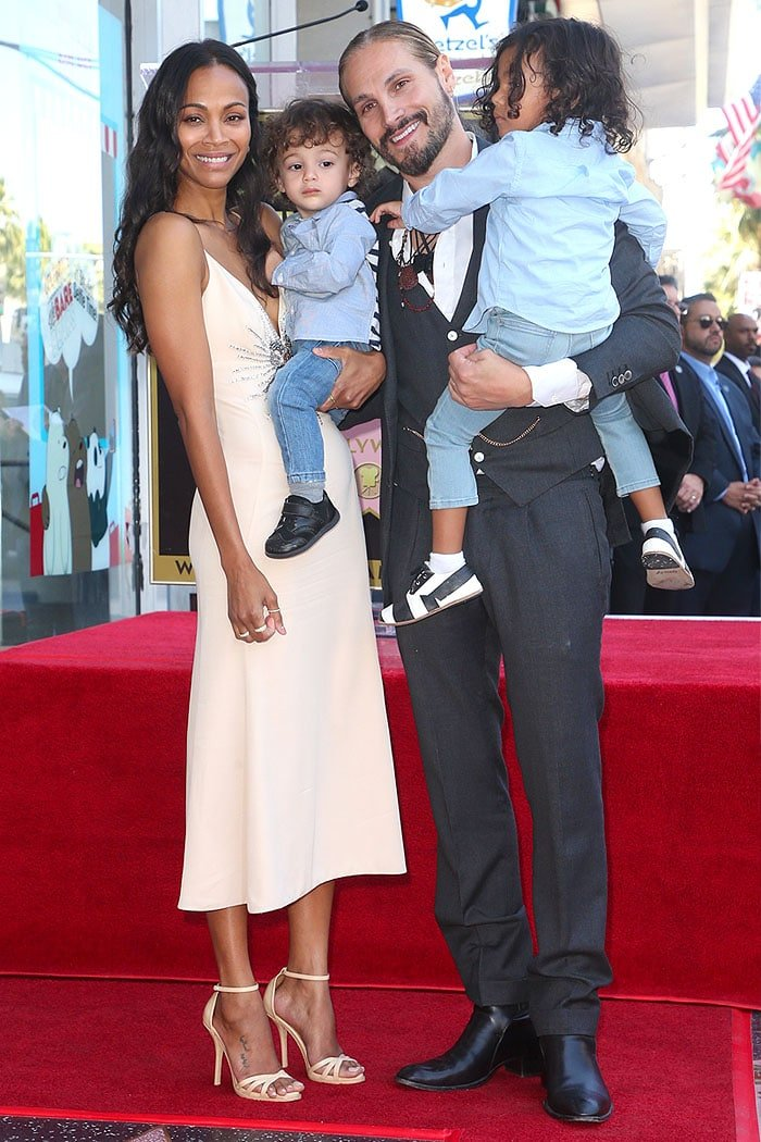 Zoe Saldana posing on the Hollywood Walk of Fame with husband Marco Perego and their sons.