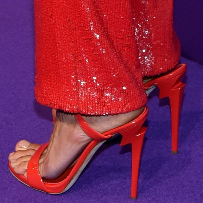 Alessandra Ambrosio sporting red patent leather G Heel sandals with sculpted heels