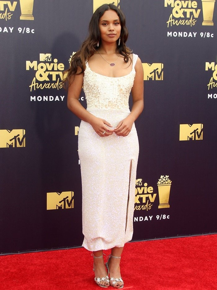 Alisha Boe in a sequin corset dress by Markarian featuring a low scoop neckline and a front leg slit