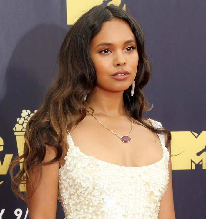 Alisha Boe showing off her ruby, diamond & yellow gold necklace at the 2018 MTV Movie & TV Awards at Barker Hangar in Santa Monica, California, on June 16, 2018