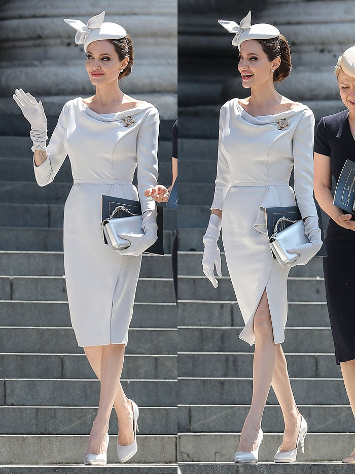 Angelina Jolie wearing a dove-gray Ralph & Russo dress, a fascinator hat, and gloves