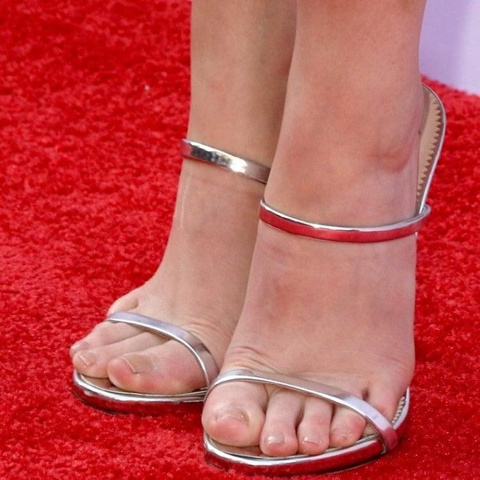 Anna Kendrick's feet in silver 'G Heel' mules