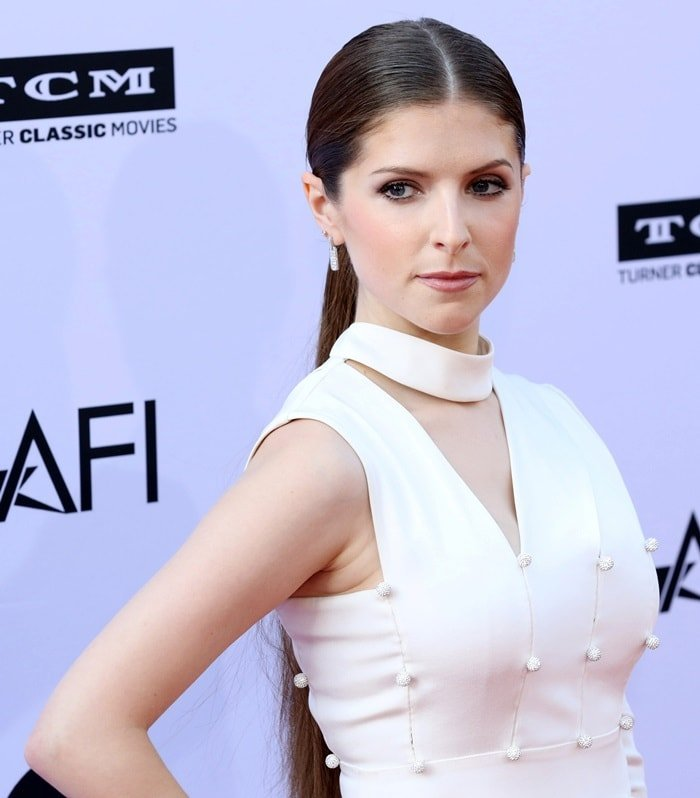 Anna Kendrick looked washed out in a snow white silk asymmetric panel dress from the Ralph & Russo Spring 2018 Collection